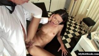 Pretty longhaired brunette, Sasha Rose, innocent looking in her knee socks, gets a