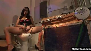 Busty Latina Raylene uses a fucking machine in her pussy and ass to